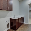 The laundry room, which connects to the walk-through owner's wardrobe.