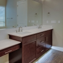 The vanity and dual sinks in the owner's bath.