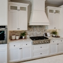 The white range hood in the kitchen perfectly compliments the white cabinetry.
