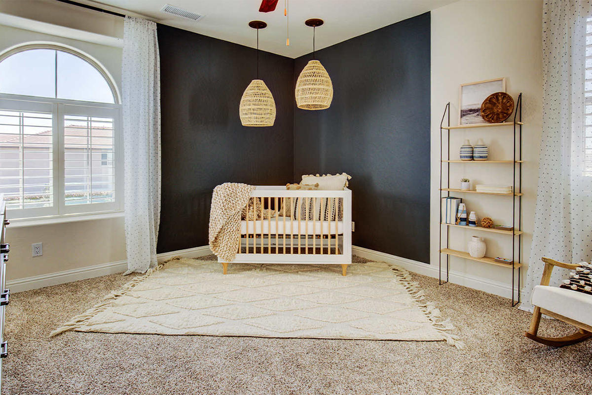 A nursery room in our Aria model home at Copper River Ranch