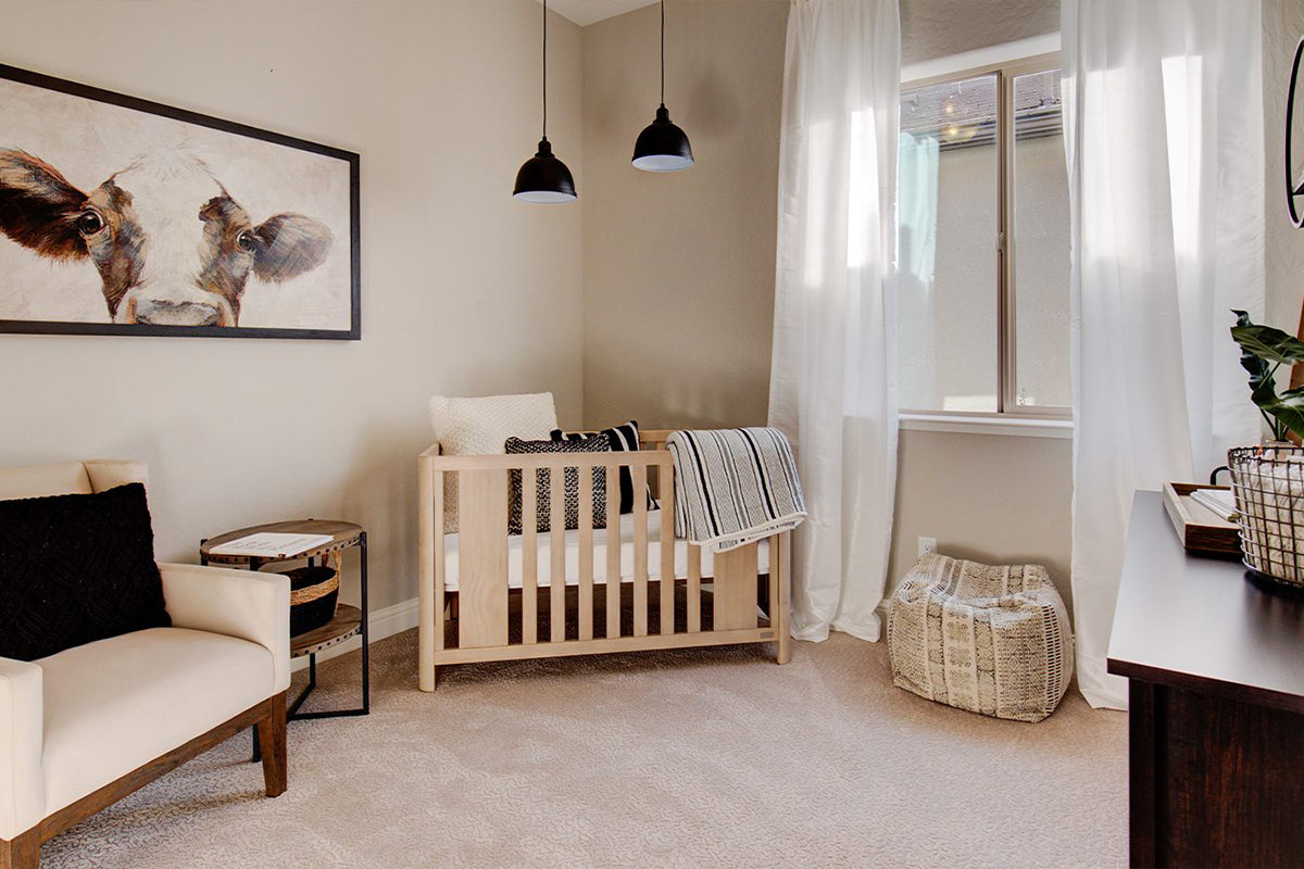 The third bedroom at our Avery model home at Copper River Ranch, staged as a nursery.