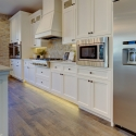 Two kitchens, a large gas cooktop, microwave, and spacious stainless steel fridge complete this gourmet kitchen.