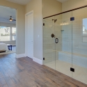 The frameless glass-walled shower in the owner's bath.