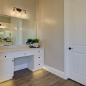 The vanity at the owner's bath, with warm under-cabinet lighting.