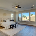 Large windows allow for plenty of natural light in the owner's suite.