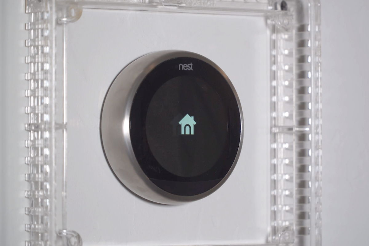 A house icon displays on the Nest thermostat's screen as it restarts.