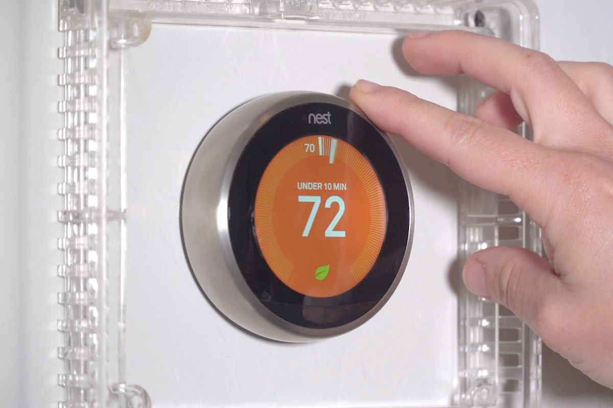 Adjusting the Heat setting on a Nest thermostat.