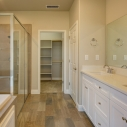 The owner's bath, with dual sinks, deep soaking tub, and large step-in shower.