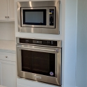 The included built-in KitchenAid microwave and oven.