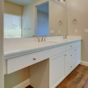 The dual sinks and vanity counter in the owner's bath.