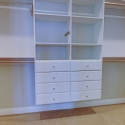 Custom shelving and drawers in the walk-through owner's wardrobe.
