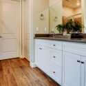 Dual sinks and plenty of storage space in the Canvas 9 owner's bath. The toilet is located in a private water closet to the left of the sinks.