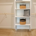 The owner's walk-in closet with custom shelving.